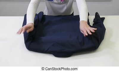 Suit jacket inspected before dry cleaning in salon -...