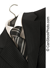 Striped black suit and tie.