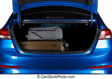 Suitcase and backpack in modern car trunk