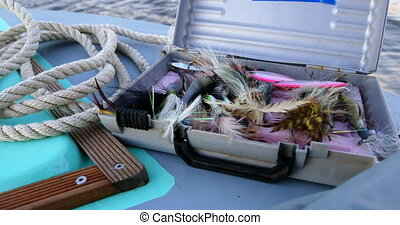 Suitcase containing of bait in motorboat 4k - Close-up of...