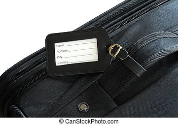 suitcase label - black leather label on a black suitcase