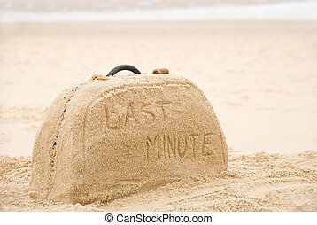 Suitcase made out of sand with writing