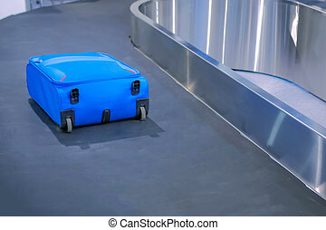 Suitcase on the airport luggage conveyor belt