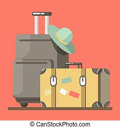 Suitcase on wheels with hat and old fashioned valise...