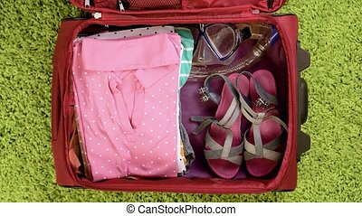 Suitcase with summer clothing