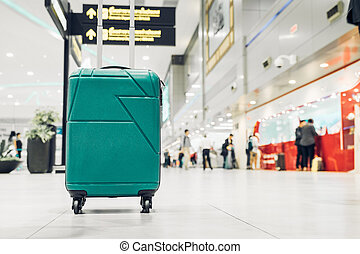 Suitcases in airport departure terminal with traveler people...