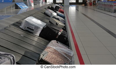 Suitcases on the baggage conveyor belt at the airport.