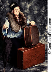 suitcases - Beautiful old lady in an elegant old-fashioned...