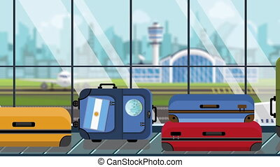Suitcases with Argentinean flag stickers on baggage carousel in airport, close-up. Travel to Argentina related loopable cartoon animation