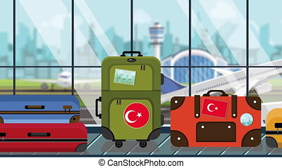 Suitcases with Turkey flag stickers on baggage carousel in...