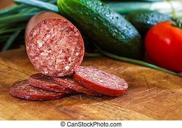 Sujuk sausage on cutting board