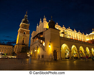 Sukiennice and Town Hall Tower in Krakow by night, Poland