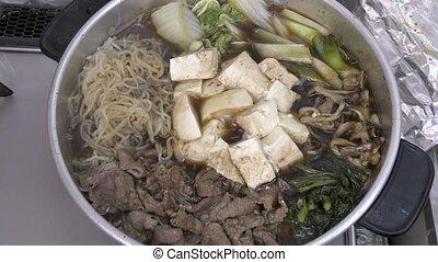 Sukiyaki during cooking - Sukiyaki hot pot during cooking...