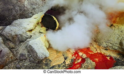 Sulfur mine at Ijen crater - Close view on sulfur mine and...