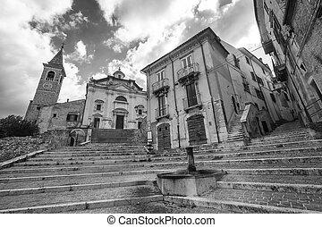 Popoli (L'Aquila, Abruzzi, Italy): facade of the Santissima Trinita, historic church. Black and white