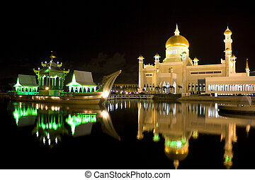 Night image of Sultan Omar Ali Saifuddien Mosque and the Ancient Royal Barge, Bandar Seri Begawan, Brunei.