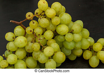 Sultana grape on the dark grey kitchen table