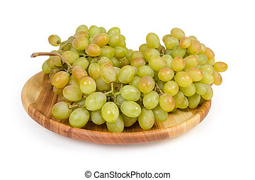 Sultana grape on vintage wooden dish on a white background