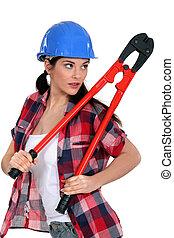 Sultry brunette holding bolt cutter