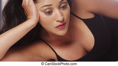 Sultry Mexican woman looking at camera