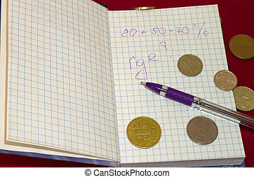 Summarize financial matters. Coins in the notebook.