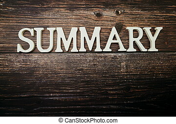 Summary alphabet letters on wooden background