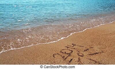 Summer 2014 - inscription 2014 on the sandy beach