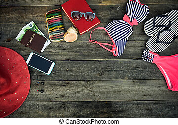Summer accessories on a wooden background