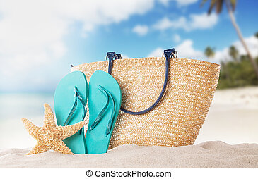 Summer accessories on sandy beach