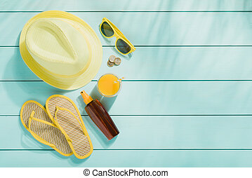 Summer accessories on wooden background top view