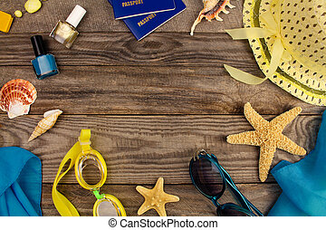 Summer accessories on wooden old background. Top view.