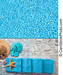 Summer accessories on wooden planks