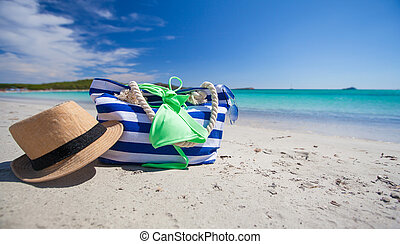 Summer accessories, swimsuit, sun glasses, bag and hat on ...