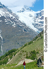Summer Alps mountain and woman on walk - Summer Alps...