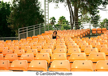 Summer amphitheater - Plastic chairs in summer amphitheater.