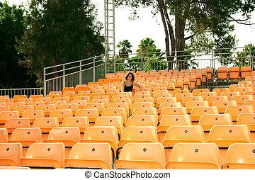 Summer amphitheater - Plastic chairs in summer amphitheater.