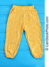 Summer baby girl trousers, top view.