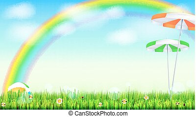 Summer background. Big bright rainbow above green field. Juicy grass, daisy flowers, ladybugs in grass on backdrop from blue sky with clouds. Landscape with Solar umbrella and inflatable ball