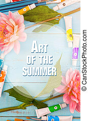 summer background. dahlias, paints, brushes and canvas on a blue wooden background with the inscription art of the summer
