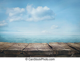 Summer background - Wood table and tropical landscape in the...