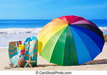 Summer background with rainbow umbrella and beach bag