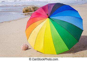 Summer background with rainbow umbrella