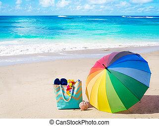 Summer background with rainbow umbrella and beach bag -...