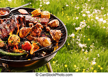 Summer barbecue cooking over a hot fire