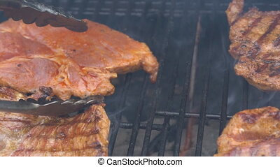 Summer BBQ Grill Thick Pork Chops slow motion