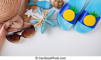 Summer beach accessories on white background, top view