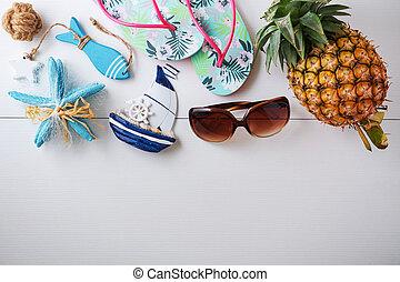 Summer beach accessories on white wood background