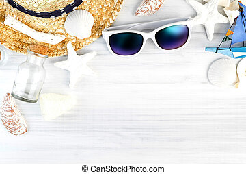 Summer Beach accessories (White sunglasses, starfish, straw hat, glass bottle, shell) on white plaster wood table top view, Summer vacation concept, Leave space for adding text..
