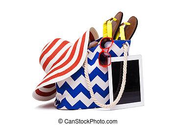 Summer beach bag and computer
