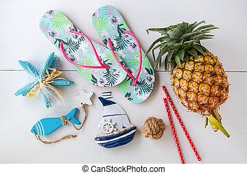 Summer beach vacation accessories on white background